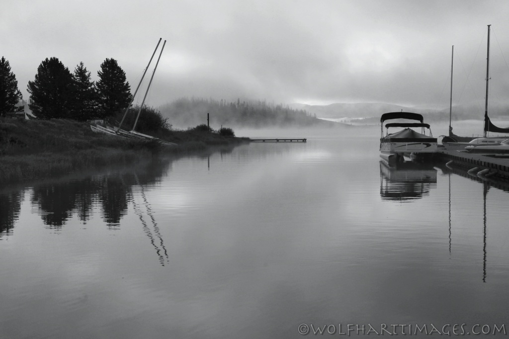 Steamboat Lake in the fog with boats
